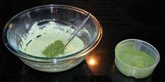 A bowl with homemade paint and green natural paint pigment, ready to be stirred together