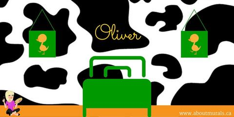 A black and white cow patterned mural on the wall behind a green bed. A boy's name, Oliver, is also on the mural.