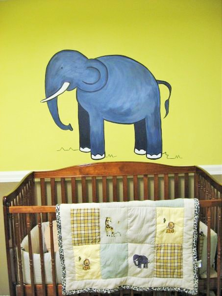 An animals mural featuring an elephant, inspired by the bedding, painted by Adrienne of AboutMurals.ca