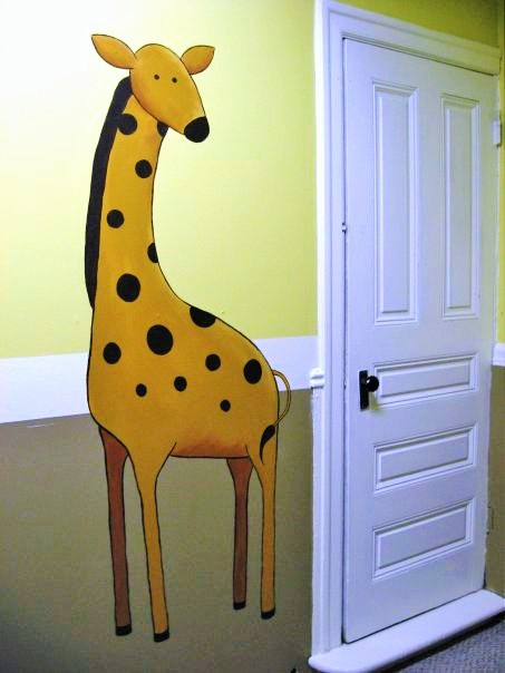 An animals mural featuring a giraffe painted by Adrienne of AboutMurals.ca