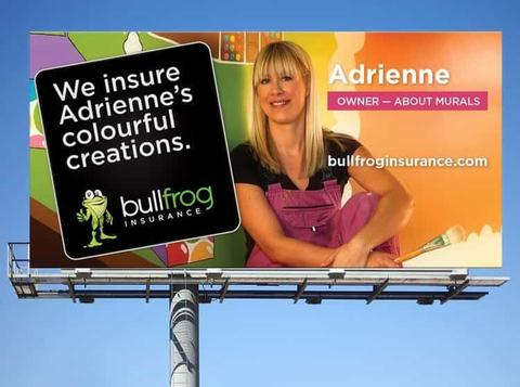 A billboard from bullfrog insurance features a photo of Adrienne of AboutMurals.ca in front of a wall mural
