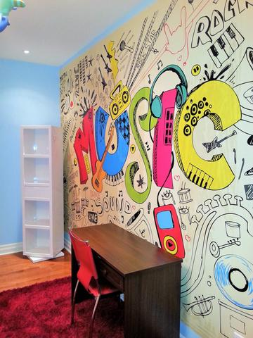 A graffit and music themed mural centred horizontally on a blue wall, leaving wall space showing at the top and bottom of the mural