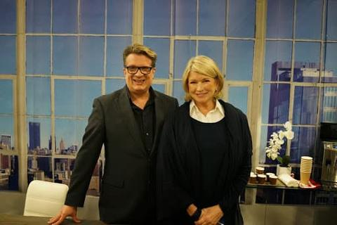 Martha Stewart and designer Karl Lohnes stand in front of a custom wall mural of the New York skyline