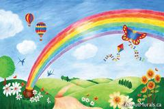 A kids wall mural featuring a rainbow in a blue, cloudy sky with hot air balloons and a kite.