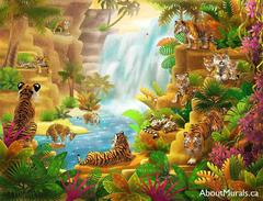 A kids wall mural featuring tigers sitting in a lush forest overlooking a waterfall.