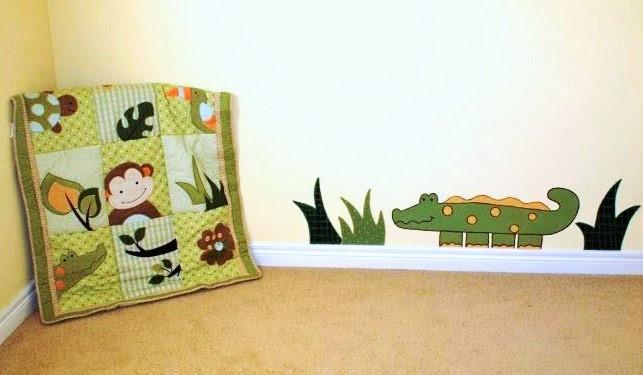 A rainforest mural featuring an alligator painted by Adrienne of AboutMurals.ca