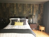 An antique wood wall mural in a bedroom, sold by AboutMurals.ca