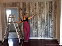 A barn wood wall mural black and white in a living room. Sold by AboutMurals.ca.