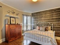 Horizontal Barn Wood Wall Mural in a bedroom, sold by AboutMurals.ca