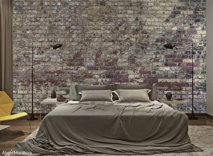 A brick wallpaper sits behind a bed in a bedroom
