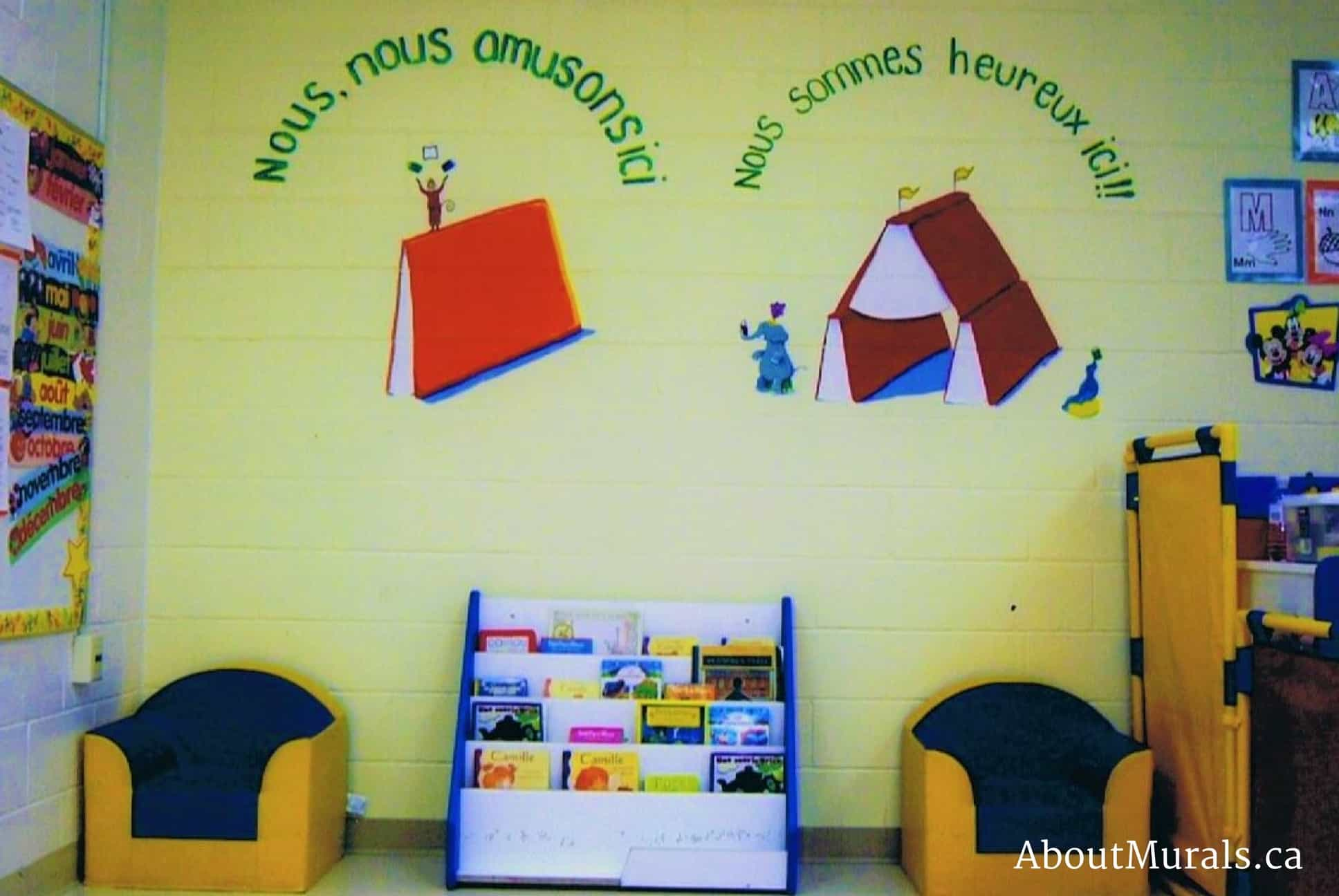 A kids wall mural featuring an elephant, seal and monkeys performing at a book themed circus