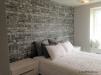 A grey brick wallpaper in a light and airy bedroom, sold by AboutMurals.ca