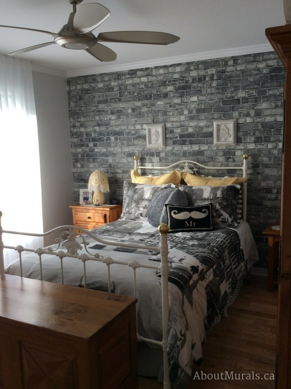 A grey brick wallpaper in a manly bedroom, sold by AboutMurals.ca