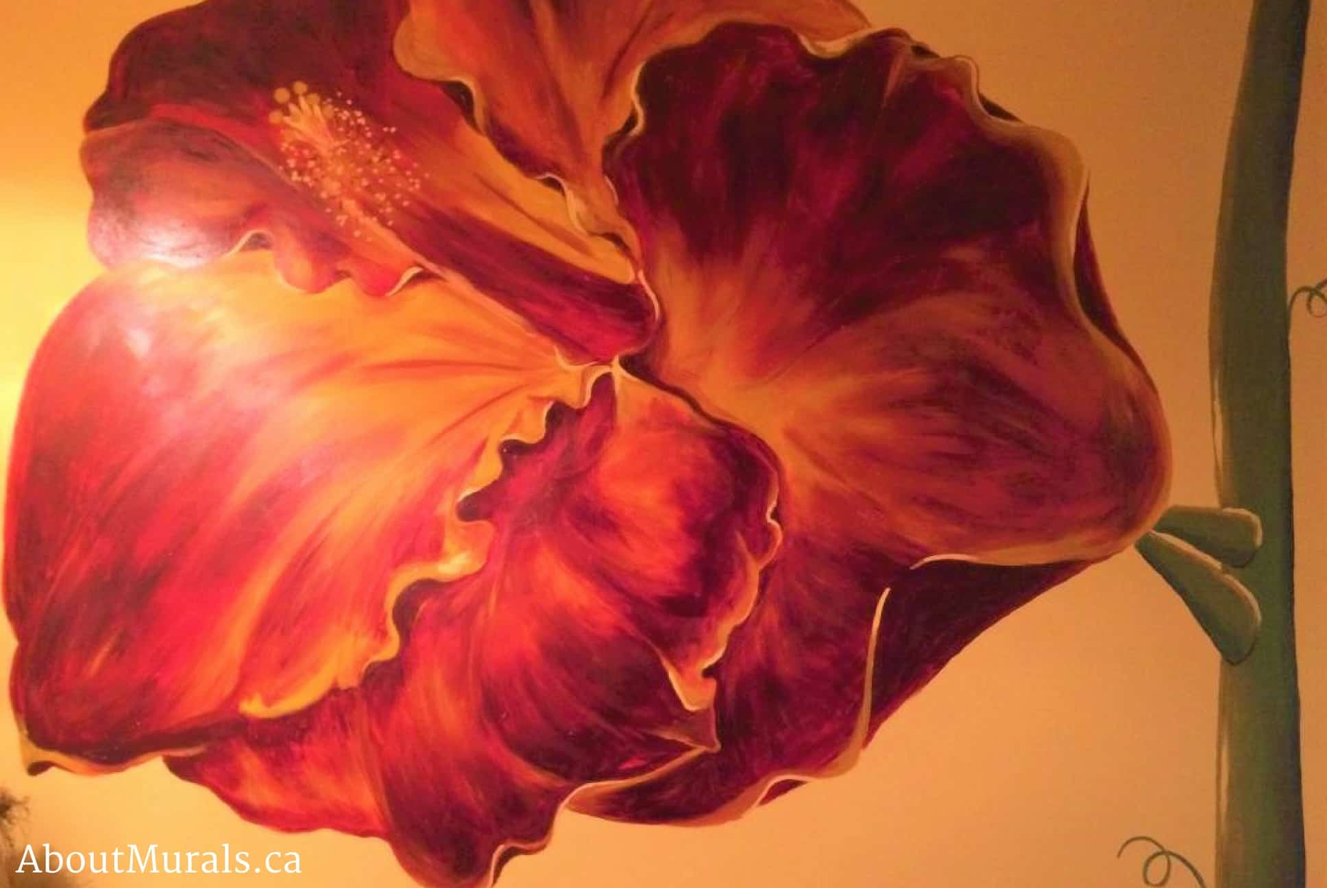 A hibiscus flower mural painted in burgundy and gold