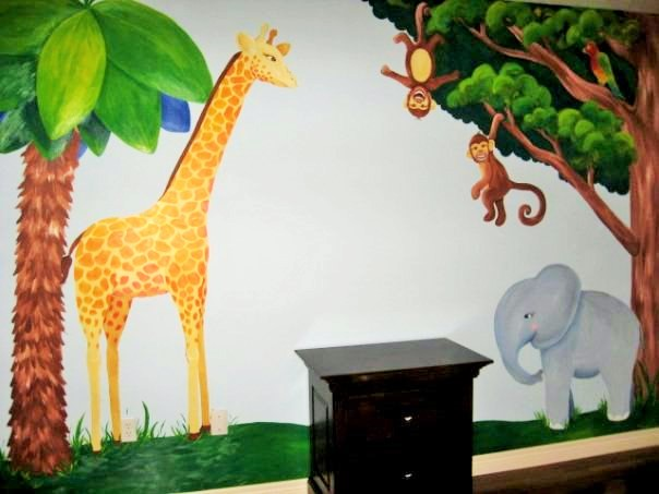 A jungle wall mural featuring a giraffe, elephant and monkeys, painted by Adrienne of AboutMurals.ca
