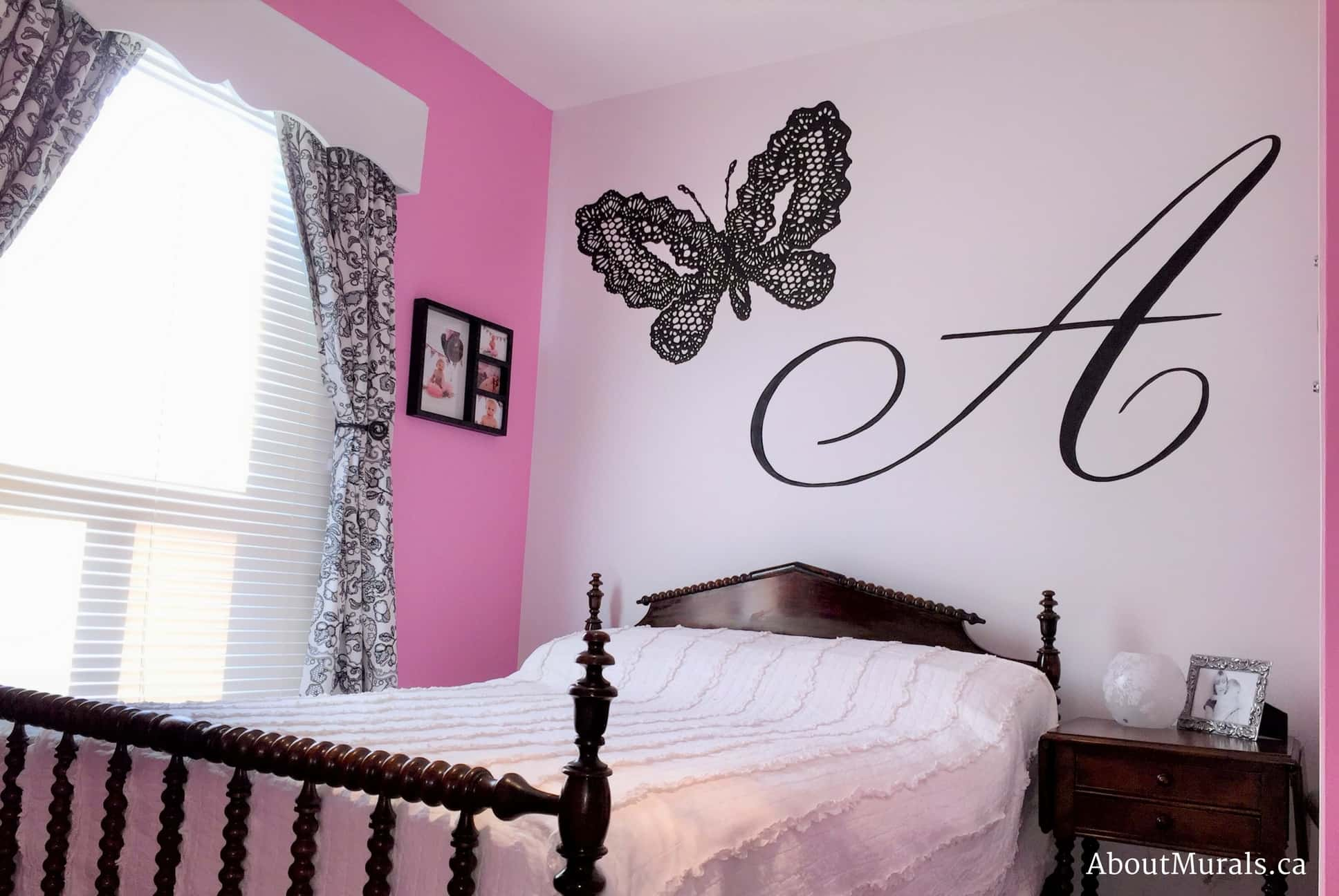 A kids wall mural featuring a black lace butterfly beside the letter A