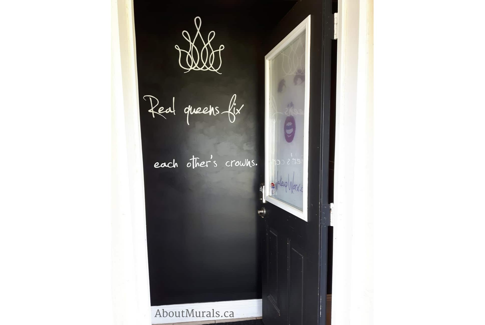 """A hand painted quote saying """"Real Queens fix each other's crowns"""""""