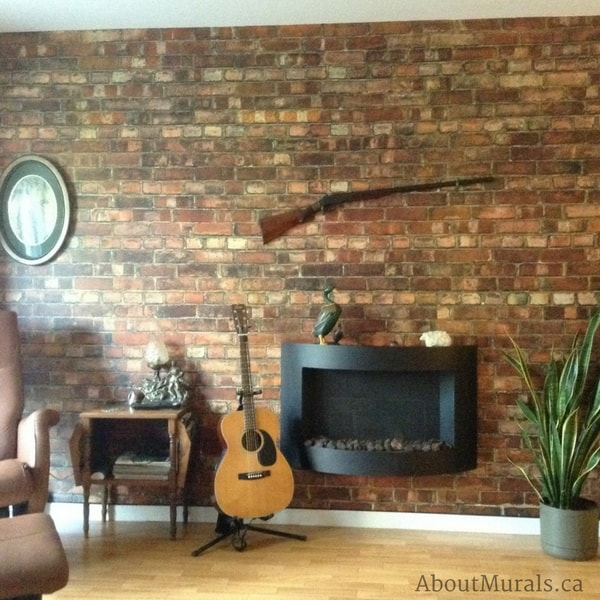 An old brick wallpaper creates a warm feeling man cave, decorated with a reclining chair, guitar and fireplace