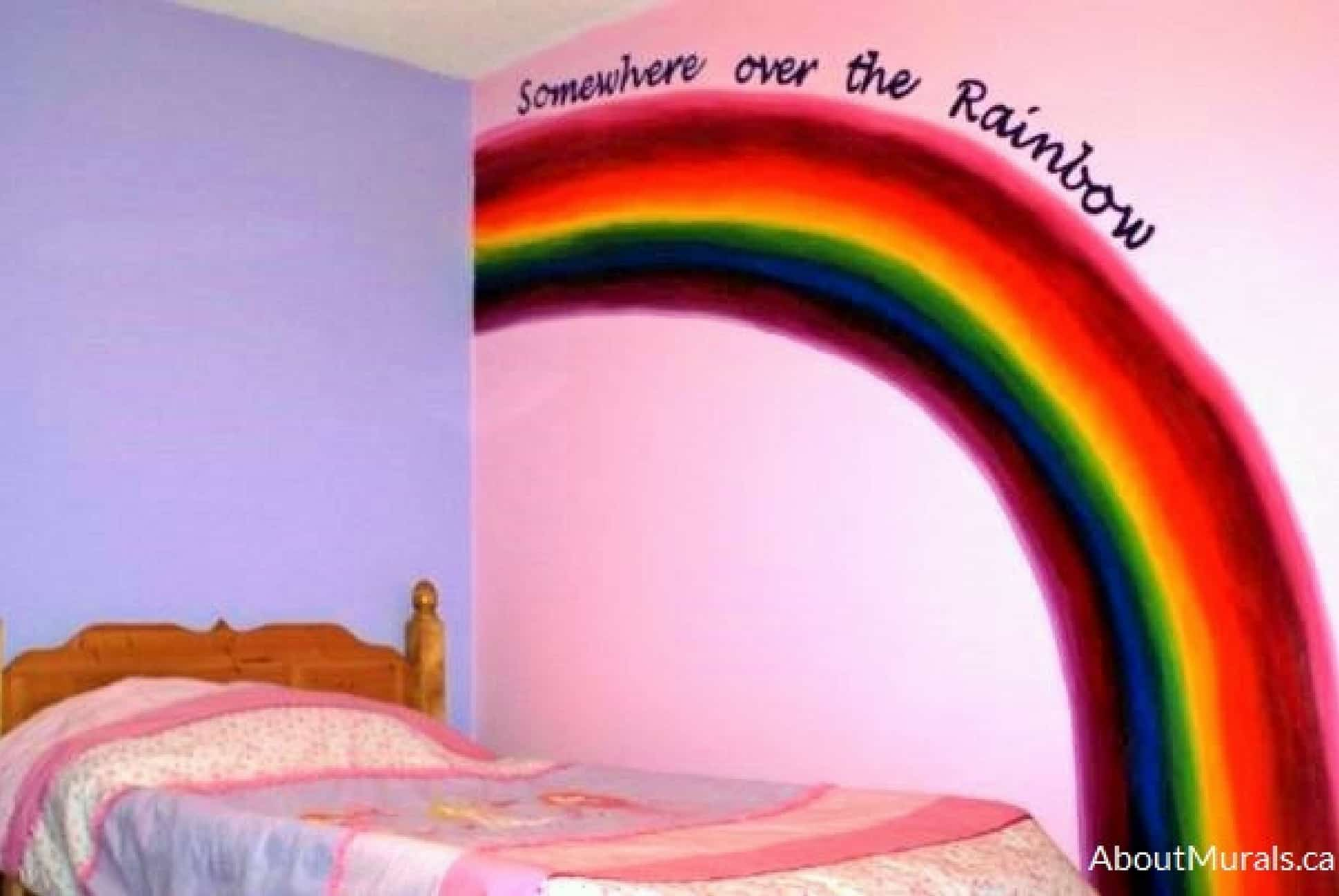 A rainbow mural painted on a pink wall in a girl's bedroom