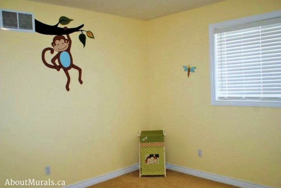 A rainforest mural featuring a monkey hanging from a vent in a girl's bedroom, painted by Adrienne of AboutMurals.ca