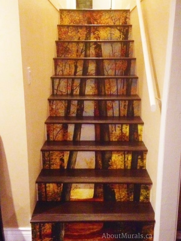 A stair riser wallpaper in a forest theme with dark stair treads, sold by AboutMurals.ca