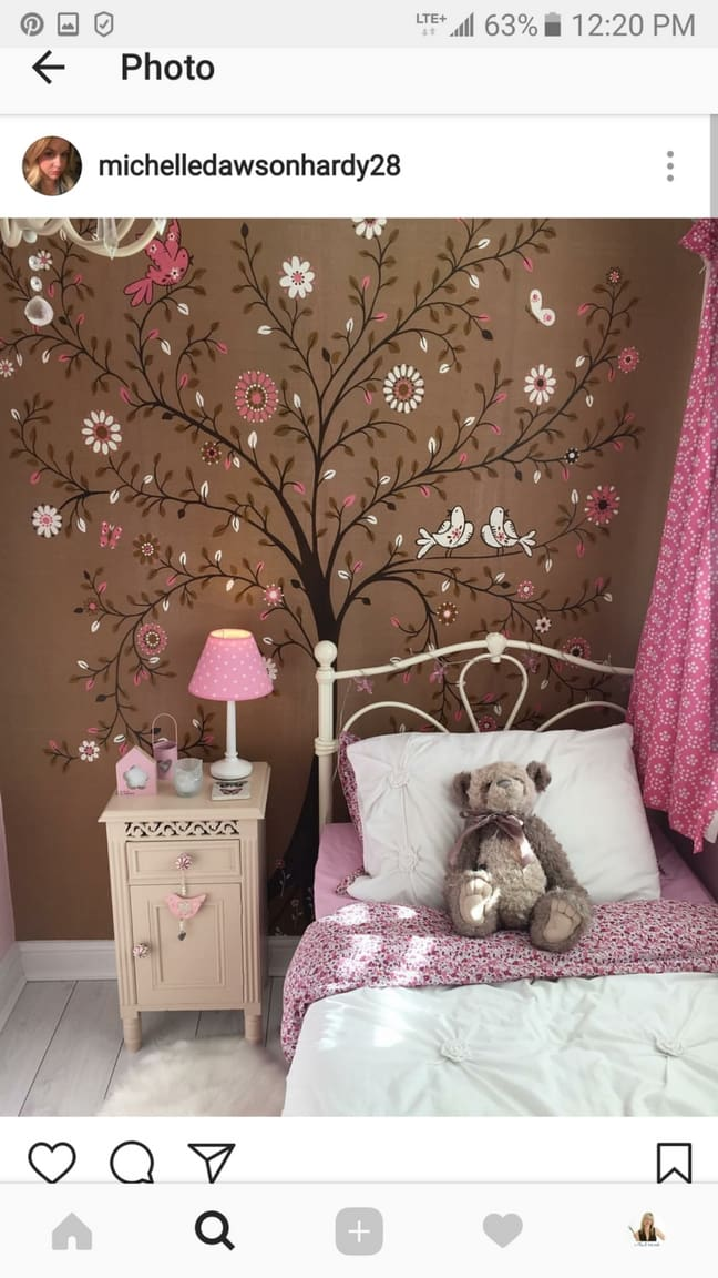 Michelle shares how to remove wallpaper bought from AboutMurals.ca on her Instagram Story. She removed her daughter's pink and brown tree of life wallpaper easily.