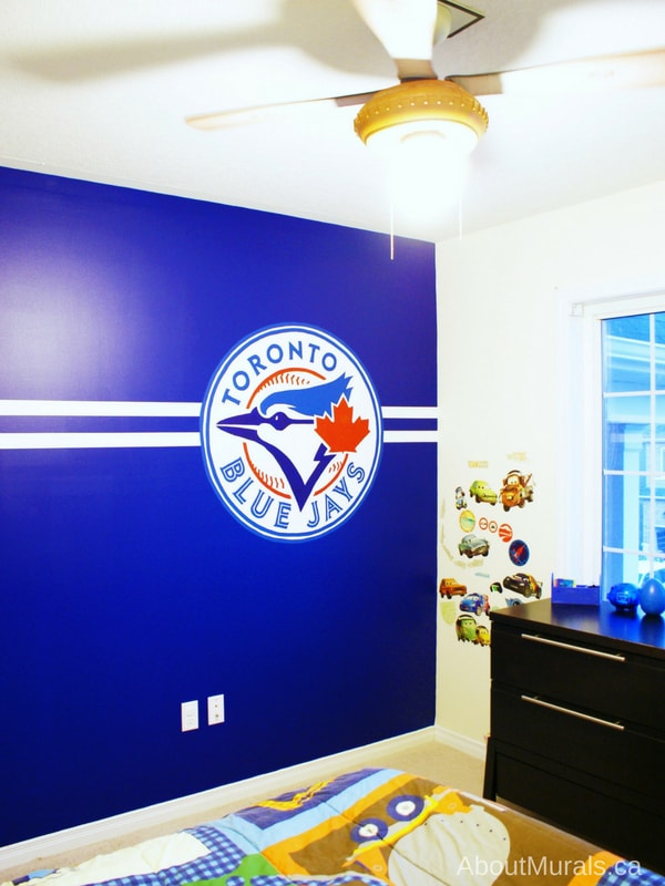 A baseball mural, painted by Adrienne of AboutMurals.ca, of a Toronto Blue Jays logo