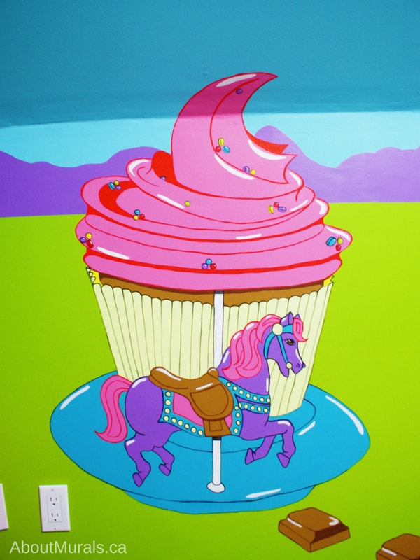 This candy mural features a horse on a cupcake carousel, painted by Adrienne of AboutMurals.ca