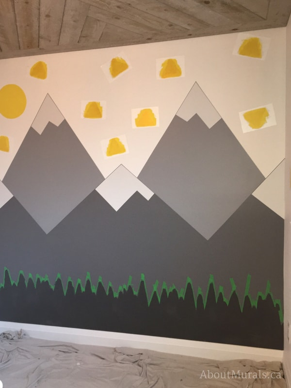 Create a DIY mountain mural by taping off a forest silhouette like Adrienne of AboutMurals.ca
