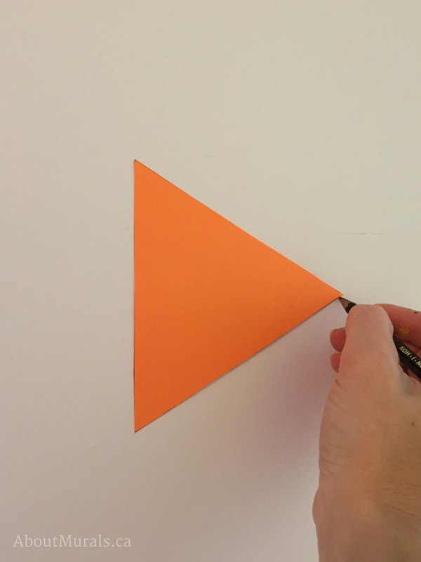 Create a triangle in a DIY mountain mural by using a stencil like AboutMurals.ca