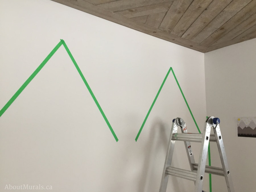 DIY Mountain Mural by taping off the upper mountains on the wall like Adrienne of AboutMurals.ca