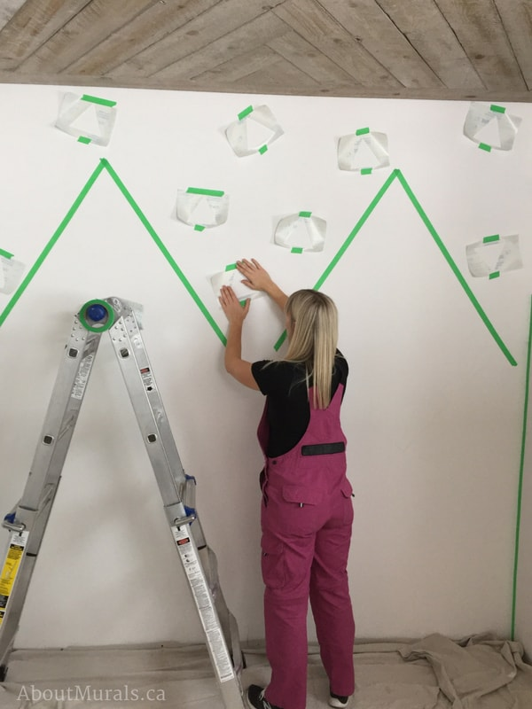 Create a DIY mountain mural and triangles by using tape and stencils like Adrienne of AboutMurals.ca