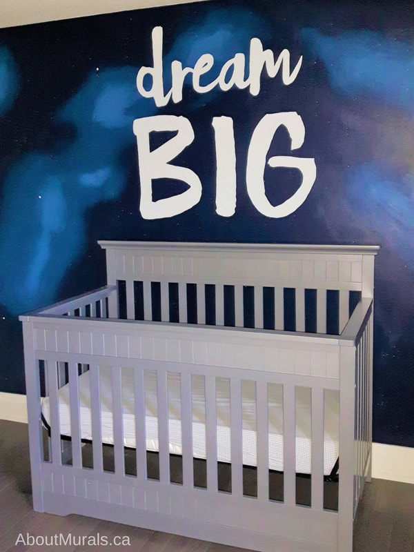 A dream big mural painted on an outer space background by muralist Adrienne of AboutMurals.ca