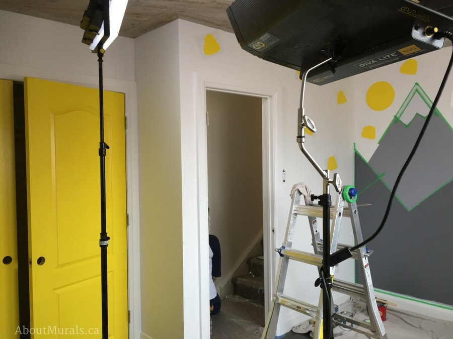 Holmes Next Generation lighting and cameras filming the mountain mural being painted by Adrienne of About Murals