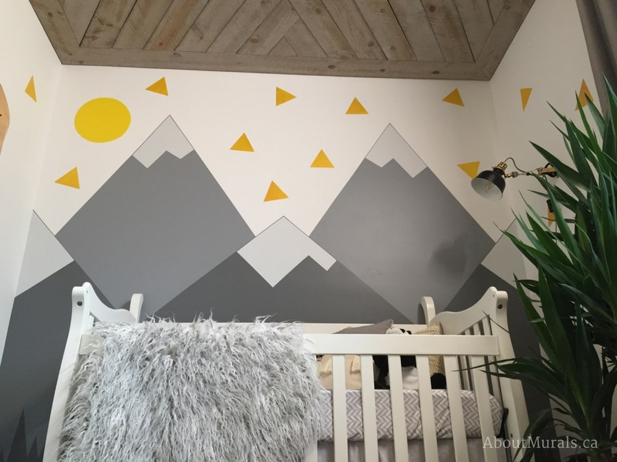 A grey mountain mural painted by Adrienne of AboutMurals.ca for Holmes Next Generation TV show in a baby nursery