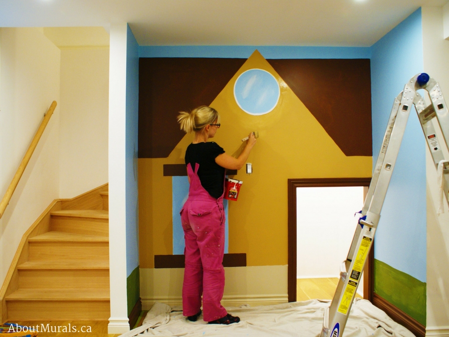 Muralist Adrienne Scanlan paints a playhouse mural