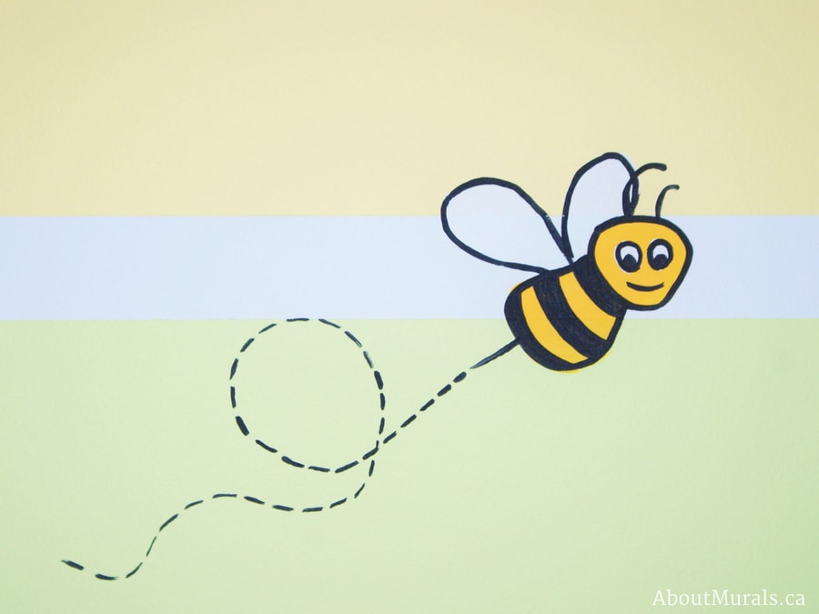 A Winnie the Pooh mural featuring a honey bee flying around the nursery, painted by Adrienne of AboutMurals.ca