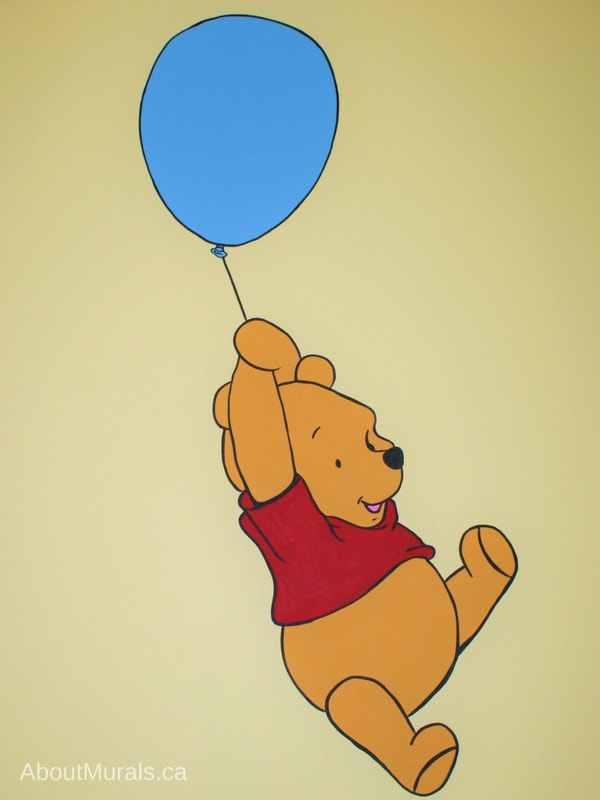 A Winnie the Pooh mural featuring the adorable bear floating by balloon, painted by Adrienne of AboutMurals.ca