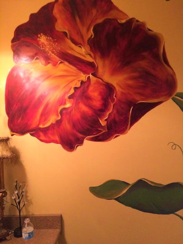 A hibiscus mural painted in red and gold colours by Adrienne of AboutMurals.ca