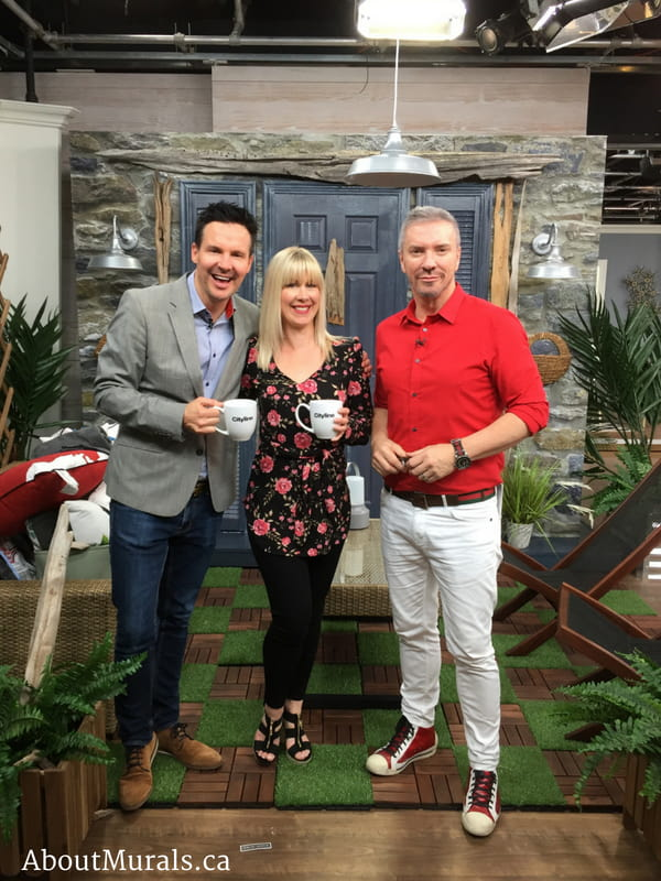Colin and Justin with Adrienne of AboutMurals.ca in front of her stone wallpaper on Cityline