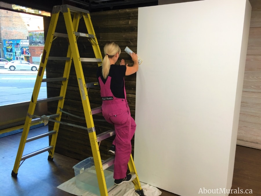 Adrienne of About Murals hangs a barnwood wallpaper for Colin and Justin on Cityline