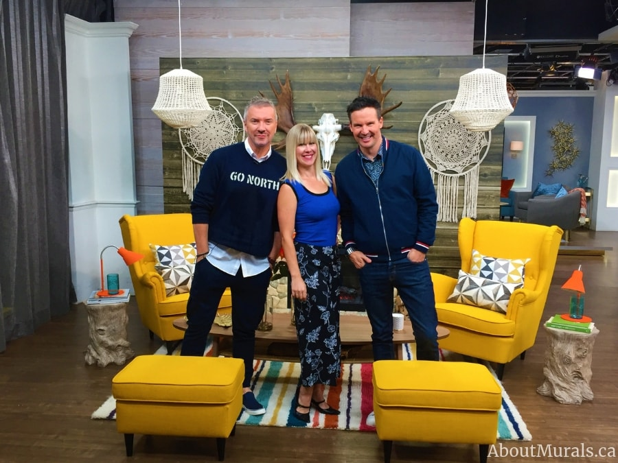 Colin and Justin, with Adrienne of About Murals, in front of a barnwood wallpaper featured on Cityline
