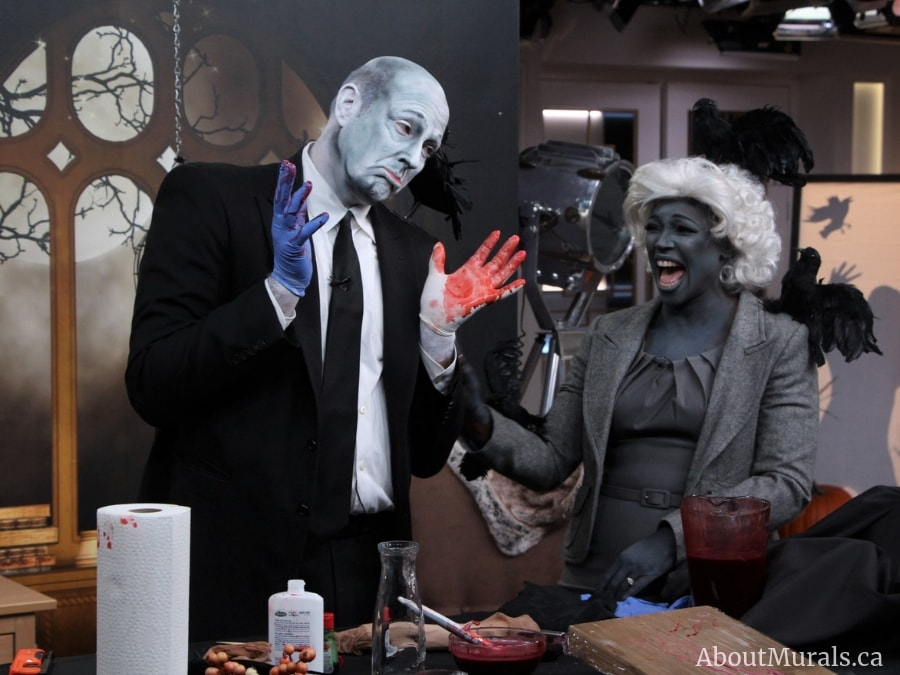 An Alfred Hitchcock inspired Halloween mural is the backdrop for Tracy Moore and Carson Arthur on Cityline.