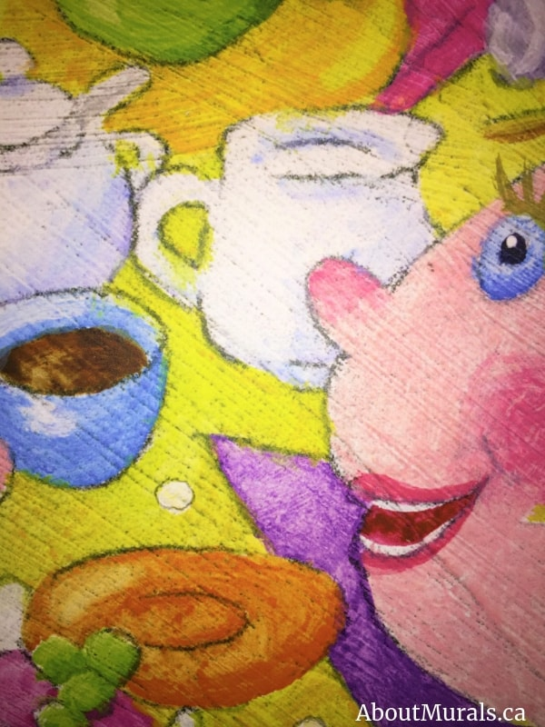 A close-up of a doll at a tea party mural, sold by AboutMurals.ca