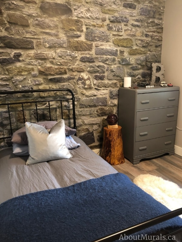 A stone wallpaper in a bedroom, sold by AboutMurals.ca