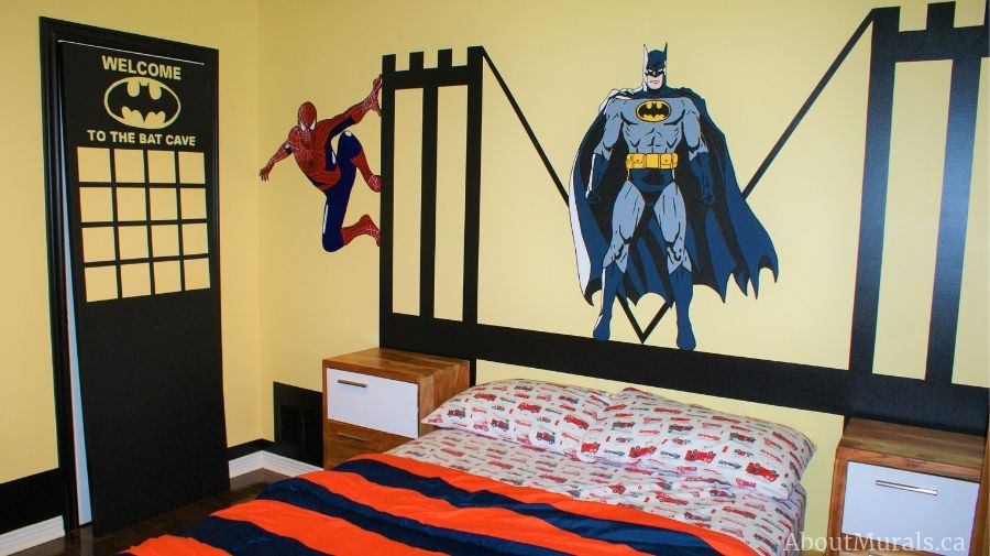 A batman wall mural, painted by Adrienne of AboutMurals.ca, features Batman and Spiderman on a bridge.