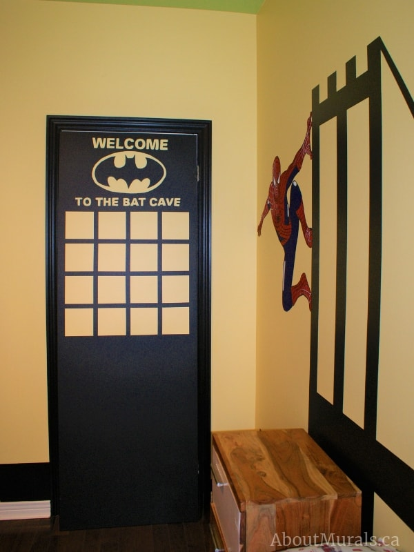 "Adrienne of AboutMurals.ca painted a closet door into a skyscraper with the words, ""Welcome to the batcave"""