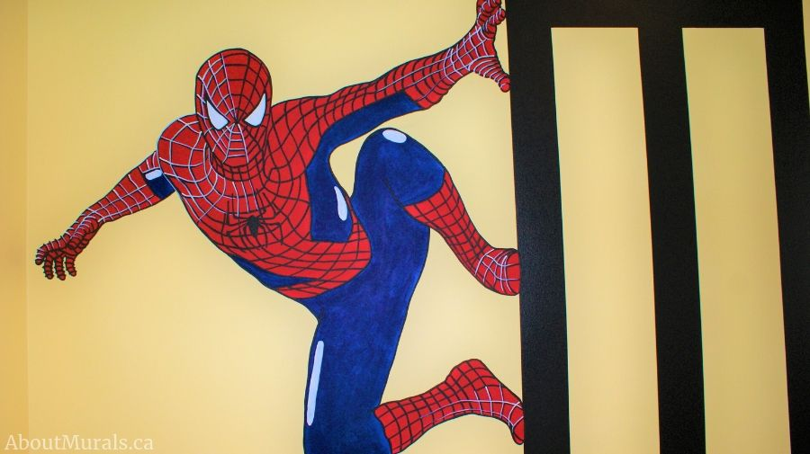 Mural artist Adrienne of AboutMurals.ca hand-painted Spiderman in a mural.