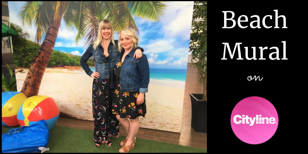 A beach mural with a palm tree is the backdrop for Adrienne Scanlan and Leigh-Ann Allaire Perrault on set at Cityline. Supplied and hung by AboutMurals.ca
