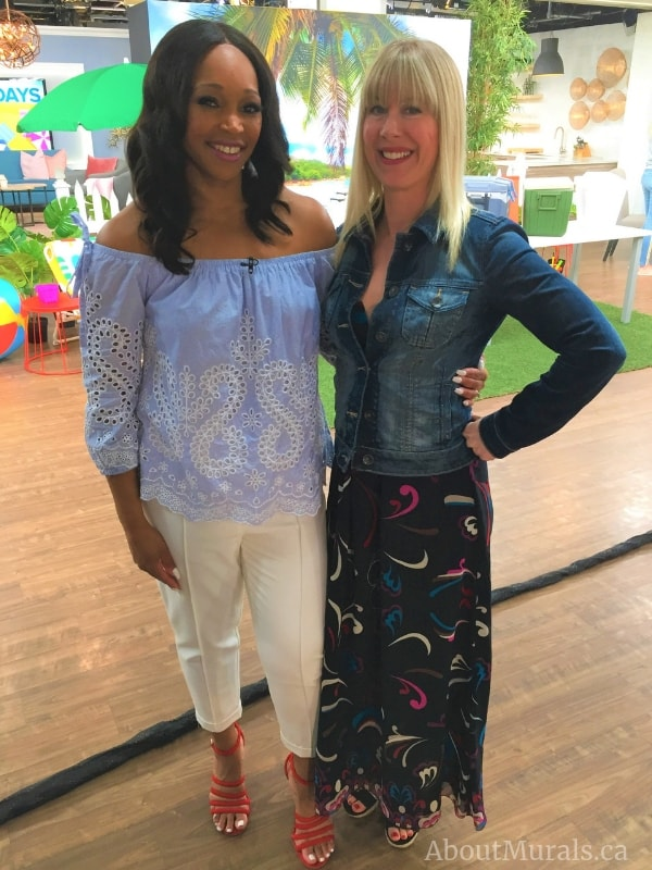 Tracy Moore and Adrienne of AboutMurals.ca stand in front of her tropical mural on Cityline